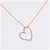 "Diamond heart presented in 14K rose gold, tilted on an angle, features .11ct total diamond weight suspended from 18"" 14K rose gold chain."