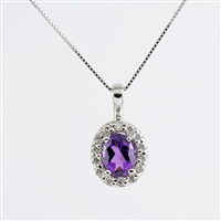 Oval amethyst with diamond halo in 14K white gold pendant.