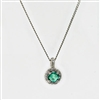 Emerald and diamond pendant in 14k white gold.