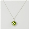 "Cushion cut peridot with diamond halo in 14K white gold suspended from 18"" white gold cable chain."