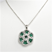 "Absolutely stunning design with pave set emeralds highlighted with black rhodium and diamonds in 14K white gold pendant suspended from sparkling 18"" 14K white gold chain."
