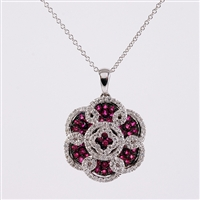 Ruby and diamond pendant in 14K white gold.