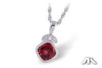 Garnet and diamond necklace in 14K white gold.