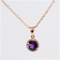 Amethyst and diamond pendant in 14K pink gold.