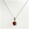 "Checkerboard cut garnet with a halo of round white diamonds in 14K white gold pendant suspended from an 18"" 14K white gold chain."