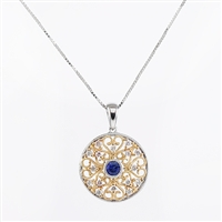 Diamond and sapphire pendant in two tone 14K gold.