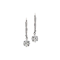 Floating 1/2ct total weight of diamonds in 14K white gold earrings.