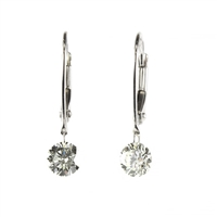 Floating 1ct total weight of diamonds in 14K white gold earrings.