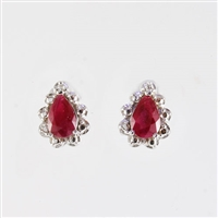 Pear shape Ruby and diamond earrings in 14K white gold.