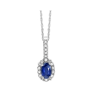 Sapphire and diamond pendant in 14k white gold.