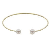 Statement piece in a 14K yellow gold cuff bracelet features two 6-6.5mm freshwater cultured pearls.