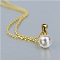 "Classic single 7mm culture pearl pendant in 14K yellow on 18"" 14K yellow gold chain."