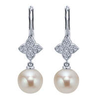 Freshwater pearl and diamond earrings in 14K white gold.