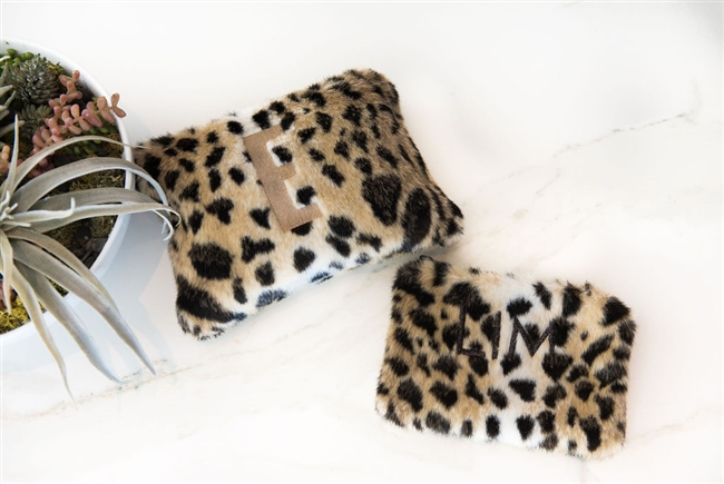 Erin Lim's Girl's Night Collection featuring faux Cheetah Pouches. Benefiting Freedom & Fashion