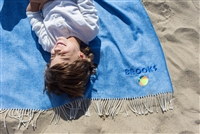 Adorable boy giggling on a blanket that is personalized with neon blue thread color and a neon beach ball graphic