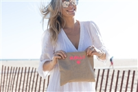 Molly Sims using her personalized neon clutch