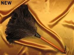 "These are ostrich feather dusters with a gorgeous stained wooden handle and leather loop. A total length of 20"" (9"" head and 11"" handle)."
