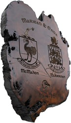 Bog wood plaque engraved with family crests. (Coat of Arms)