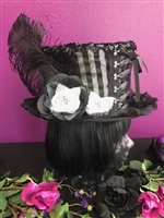 BIG TOP HAT SILVER AND BLACK All Hilary's Vanity Hats are hand made by Hilary shipping can take up to 2 weeks depending of if we have to make a new one or if it is in stock.