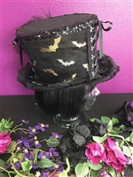 BIG TOP HAT SILVER AND GOLD BATS All Hilary's Vanity Hats are hand made by Hilary shipping can take up to 2 weeks depending of if we have to make a new one or if it is in stock.
