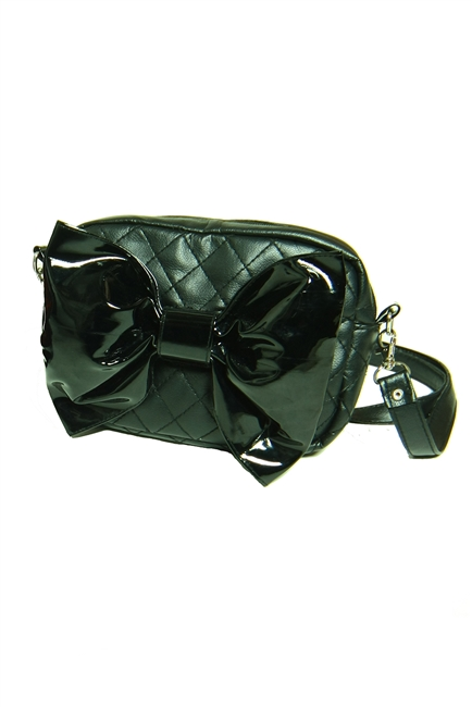 This beautiful vegan leather purse features a big black PVC bow.It also has a long removable strap. This purse will complement any Costume or outfit. Gothic inspired.