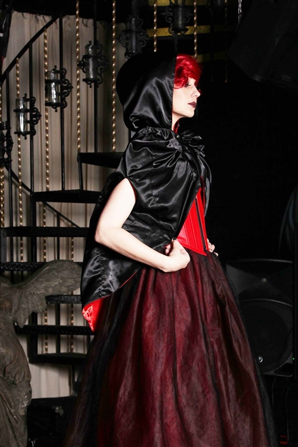 Red Satin with Black Satin hooded Cape is fully reversible and features 4 deep zipper pockets, arm holes and has princess shoulders.