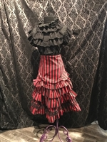 Erin Skirt is done in our Red and Black Striped Fabric and features many Layered Ruffles and a Side Zipper. This Victorian-inspired Below the knee skirt is fully lined with a 100% Polyester Lining.