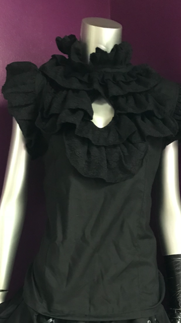 Jill Top-This top has a ruffle front detail and button closure and complements every outfit.