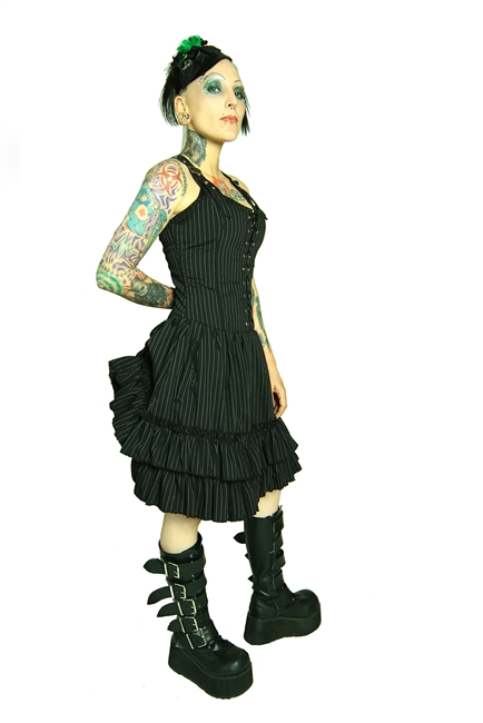 This Dress is done in our Pinstripe fabric and features an Adjustable Bustle, Layered Ruffles, and a Back Zipper and most importantly has 2 deep side pockets. Made of polyester pinstripe and has a 100% Polyester Lining. Gothic and Steampunk.