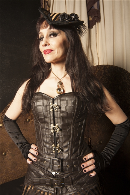 Patchwork Pleather Corset- This overbust corset is done in out Patchwork Pleather. Featuring a privacy panel, and has steel-coil boning. A Steampunk must-have!