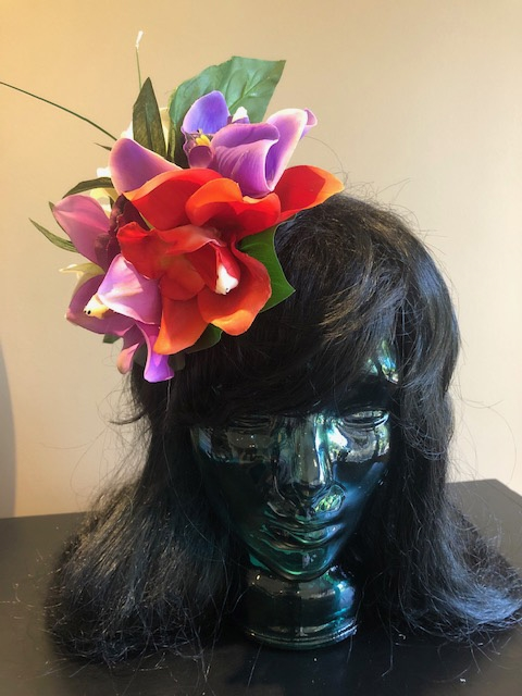 Tiki Hair Flowers- This wonderful hair clip adds a splash of color to any outfit.