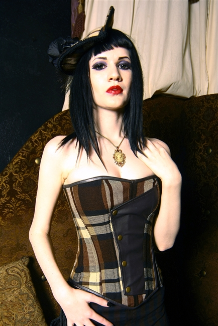 Time Traveler Corset in Brown Plaid and Brown Leather - Features Back lacing, a Side Zipper, a Privacy Panel, and has steel-coil boning. Travel through time wall looking devine a Steampunk must have!