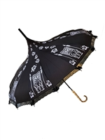 This beautiful umbrella has a black and white Tiki pattern. It features lace and bow details with a real Bamboo hook style handle.