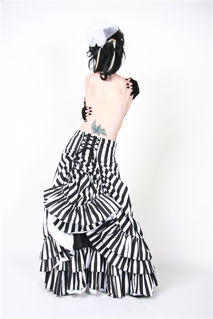V Skirt is done in our Black and White Stripes and features an Adjustable Bustle, Layered Ruffles and a Side Zipper. This Victorian-inspired skirt is fully lined with a 100% Polyester Lining.