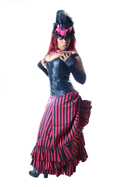 V Skirt is done in our Pink and Black features an Adjustable Bustle, Layered Ruffles and a Side Zipper. This Victorian-inspired skirt is fully lined with a 100% Polyester Lining.