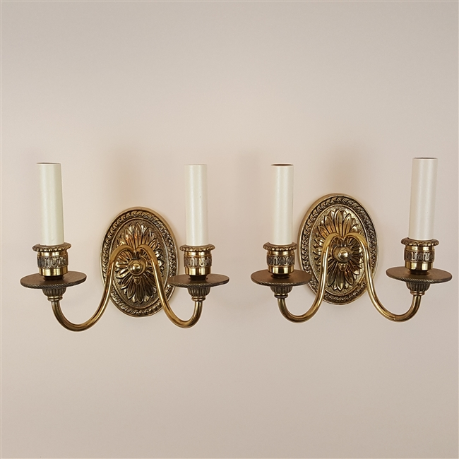 Pair of small two arm cast brass wall lights
