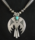 DATED JOE H. QUINTANA PENDANT WITH BEADS