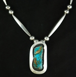 JOE H. QUINTANA TURQUOISE PIN/PENDANT WITH BEADS