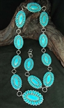 STRIKING ALICE QUAM TURQUOISE CONCHO BELT