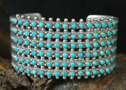BEAUTIFUL ZUNI SNAKE EYE 6 ROW CUFF