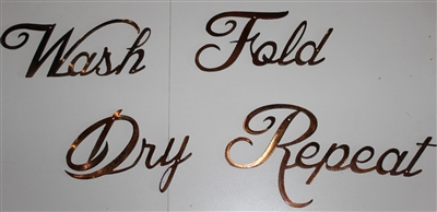 """Wash, Dry, Fold, Repeat"" Metal Word Art Decor"