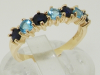 Magnificent 9K Yellow Gold Blue Topaz and Sapphire Half Eternity Ring