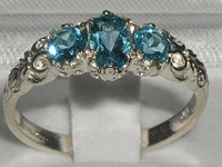 Elegant 10K White Gold Blue Topaz Trilogy Ring
