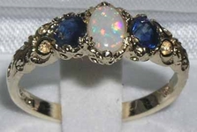 Elegant 10K Yellow Gold Opal and Sapphire trilogy Ring