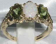 Stunning 9K Yellow Gold Oval Cut Opal and Peridot Trilogy Ring