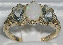 Exuberant 9K Yellow Gold Natural Australian Opal and Aquamarine Trilogy Ring