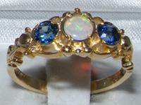 Stunning and Vibrant 14K Yellow Gold Opal and Sapphire Trilogy Ring