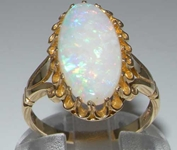 Exquisite 9K Yellow Gold Natural Australian Opal Solitaire