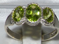 Elegant Sterling Silver Peridot Trilogy Ring