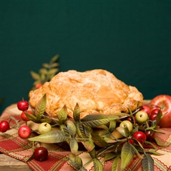 Start with a lovely holiday pie perfectly blended with fresh apples and holiday cranberries and glazed with crystal sugar. Add a beautifully decorated gift box for the season with a handsome holiday ornament.